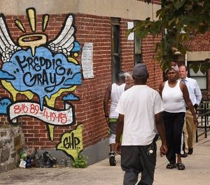 "People walk past the site where Freddie Gray was arrested, on July 27, 2016. Two Baltimore police officers have accepted ""minor disciplinary action"" for their involvement in the 2015 arrest. (Amy Davis/Baltimore Sun/TNS)"