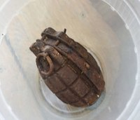 Fire station evacuated after woman drops off WWII-era grenade