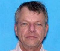 Theater gunman's family says he was mentally ill, violent