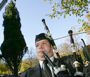 Adam Holdaway, of Chelmsford, Mass., plays the bagpipes during the annual raising of Boston's official Christmas tree on Boston Common in Boston, Friday, Nov. 18, 2005. The tree is donated each year by the Canadian province of Nova Scotia as a show of gratitude to the people of Boston for their help in the wake of the 1917 explosion in Halifax harbor. (AP Photo/Michael Dwyer)