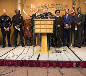 Michael Downing, LAPD Deputy Chief Counter-Terrorism, center, holds a news conference with members of law enforcement and the Muslim community after a series of letters threatening violence against Muslims, in Los Angeles on Nov. 28. (Photo/Brian van der Brug/Los Angeles Times/TNS)