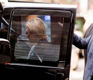 Democratic presidential candidate Hillary Clinton gets into a van as she leaves an apartment building Sept. 11. (AP Photo/Andrew Harnik)