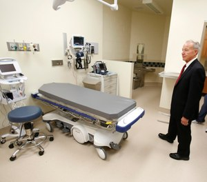 In this June 25, 2013 file photo, Jeffrey Beard, secretary of the California Department of Corrections and Rehabilitation, looks over an emergency care room while touring the California Correctional Health Care Facility in Stockton, Calif. (AP Photo)