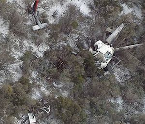 A medical helicopter crashed in rugged terrain east of Phoenix, killing two crew members and seriously injuring a third. (ABC-15.com via AP)