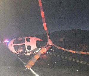N.M. helicopter struck and tipped over by an impaired driver. (Photo/McKinley County Sheriff's Office)