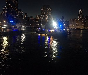 A helicopter has crashed into New York City's East River. (Photo/AP)