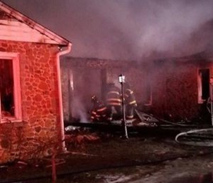 A mayday call went out Monday after an assistant chief fell through the floor of a burning home while searching for occupants. (Photo/Office of the State Fire Marshal)