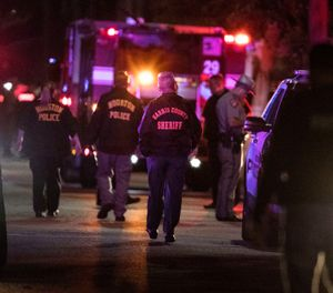 Houston police during a deadly drug raid that left 2 fatally shot and 5 officers injured (Photo/ AP)