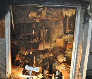 The firefighter died in a floor collapse while he was working above a residential basement fire. (Photo/NIOSH)