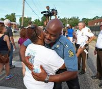 Details emerge in Mo. shooting, protests calm
