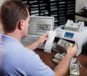 The JetScan iFX desktop series money counters from Cummins Allison process cash at 1,200 bills per minute, capturing every bill image and serial number and analyzing each bill for counterfeit detection. (image/Cummins Allison)