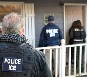 In this Feb. 9, 2017, photo provided U.S. Immigration and Customs Enforcement, ICE agents at a home in Atlanta, during a targeted enforcement operation aimed at immigration fugitives, re-entrants and at-large criminal aliens. (Bryan Cox/ICE via AP)