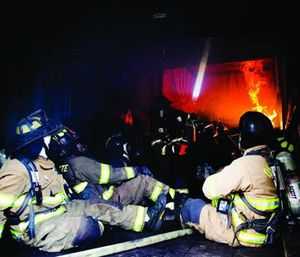 Firefighters partake in the flashover simulator/