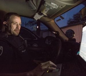 Having access to relevant information while en route to a call helps command centers dispatch appropriate resources and helps law enforcement officers gain situational awareness before arriving on scene. (photo/PoliceOne)