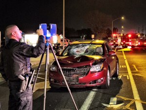 An officer uses a laser scanner to investigate the scene of an accident. (Photo courtesy of FARO Technologies)