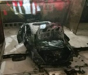 A car plummeted nine stories from a downtown Miami parking garage after it was left in gear and burst into flames. (Photo/MFR)