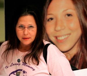 Margie Weiss, mother of Rachel Hoffman, shown in photo at right, waits for a news conference to start after the House of Representatives passed the confidential informants bill, Monday, April 27, 2009, in Tallahassee, Fla. (AP Photo/Phil Coale)