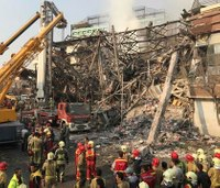 Collapse of burning Iran high-rise kills 30 firefighters