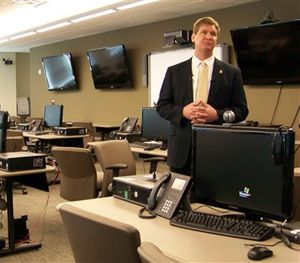 This March 9, 2012, file photo shows FBI spokesman Kyle Loven giving a tour of the Emergency Operations Center at the new Minneapolis-area field office in Brooklyn Center, Minn. (AP Image)