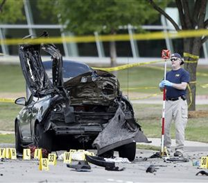 An FBI crime scene investigator documents evidence outside the Curtis Culwell Center, Monday, May 4, 2015, in Garland, Texas. (AP Image)