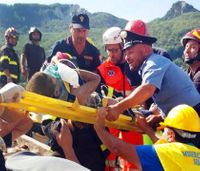 Italian firefighters pull 3 children from rubble on quake-hit island