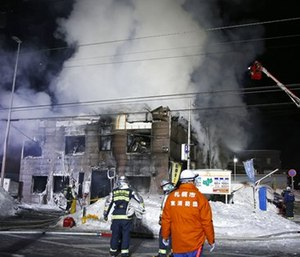 Firefighters work at the scene of a fire in Sapporo, northern Japan. (Yuya Shino/Kyodo News via AP)