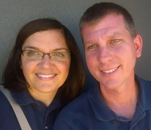 Jeannie and Jason sitting in a compartment in a ladder truck. (Courtesy photo)