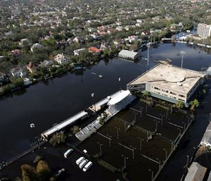 The Tulane University campus is covered by floodwaters from Hurricane Katrina Wednesday, Sept. 7, 2005 in New Orleans. (AP Photo/David J. Phillip, Pool)