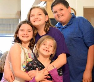 This 2017 photo provided by Torie McCallum shows Sutherland Springs First Baptist Church shooting victims, from left, Megan Hill, Emily Hill, Greg Hill and survivor Evelyn Hill, bottom, in Floresville, Texas. Evelyn survived the Nov. 5 shooting at the church but her brother and sisters along with her mother, who was pregnant, were killed. (Torie McCallum via AP)
