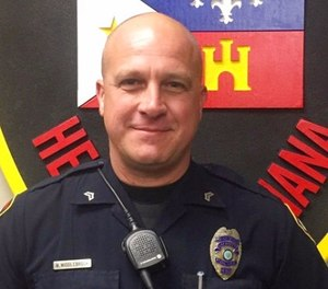 This photo provided by the Lafayette Police Department shows Cpl. Michael Paul Middlebrook, a nine-year patrol veteran who was shot and killed in the line of duty late Sunday, Oct. 1, 2017. (Lafayette Police Department via AP)