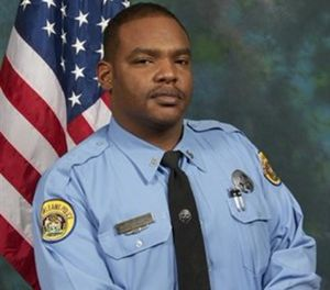 Officer Daryle Holloway was fatally shot by Travis Boys, as he was transporting Boys in his SUV. (AP Image)