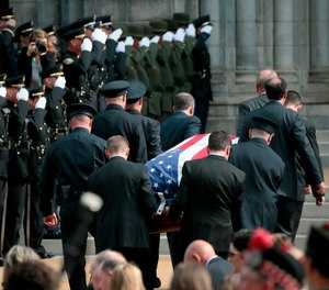 Pallbearers carry the casket of North County Cooperative Officer Michael Langsdorf inside the Cathedral Basilica of St. Louis for his funeral Mass on Monday, July 1, 2019. (Laurie Skrivan/St. Louis Post-Dispatch via AP)
