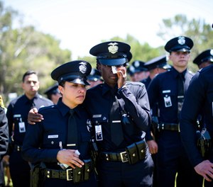 Los Angeles Police Department officers mourn during the funeral of fellow Officer Juan Jose Diaz at Forest Lawn Hollywood Hills cemetery, Monday, Aug. 12, 2019, in Los Angeles. (Sarah Reingewirtz/The Orange County Register via AP)