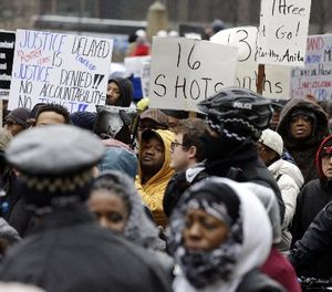 """In this Nov. 27, 2015, file photo, protesters take part in a """"march for justice"""" in Chicago, in the wake of the release of video showing an officer fatally shooting Laquan McDonald. (AP Photo/Nam Y. Huh)"""