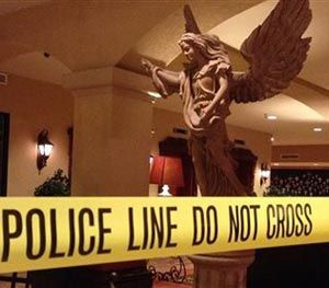 This Tuesday, Oct. 28, 2014 photo provided by the Las Cruces Police Department shows a closed off area of the Hotel Encanto in Las Cruces, NM. after a shooting. (AP/Las Cruces Police Department Image)