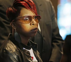 In this March 5, 2015, file photo, Lesley McSpadden, mother of Michael Brown Jr., listens to the family attorney during a news conference. (AP Image)