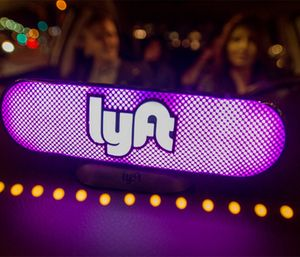 Lyft's new Amp glows on the dashboard of a car in San Francisco. (Josh Edelson/AP Images for Lyft)