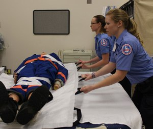 EMS providers use a friction-reducing device to move a patient (Image Bryan Fass)