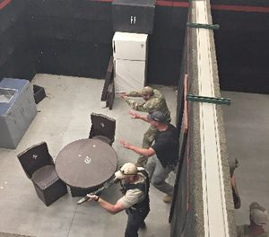 Student instructor controlling student officer's movements upon entering a room. (Photo/Dan Danaher)