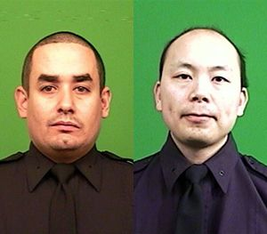 Officer Rafael Ramos (left) and Officer Wenjian Liu were shot and killed Saturday, Dec. 20, 2014, in the Brooklyn borough of New York. (AP Image)