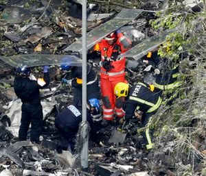 Emergency workers search debris that fell at the base of the fire-gutted Grenfell Tower in London. (AP Photo/Matt Dunham)