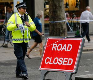 Police clear barricade tape from the scene of a knife attack near Russell Square in London, Thursday, Aug. 4, 2016. (AP Photo/Frank Augstein)