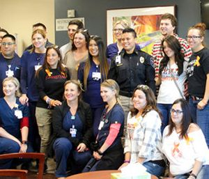 Staff of the emergency room at Spring Valley Hospital and first responders pose for a photo with survivors. (AP Photo/Regina Garcia Cano)