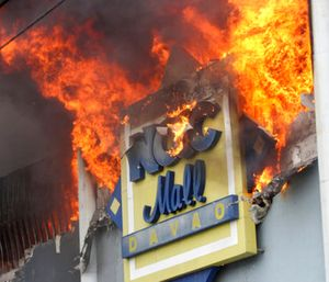 Investigators will determine the cause of the shopping mall fire and the prospects of criminal lawsuits. (Photo/AP)