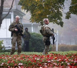 Pennsylvania State Police SWAT officers stand by as Eric Frein arrives at the Pike County Courthouse for his arraignment in Milford, Pa., Friday Oct. 31, 2014. (AP Image)