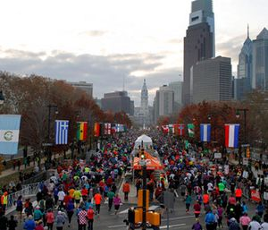 Runners make their way down Benjamin Franklin Parkway in Philadelphia during the Philadelphia Marathon. (AP Photo/ Joseph Kaczmarek)
