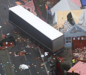 In this Dec. 20, 2016 file photo the trailer of a truck stands beside destroyed Christmas market huts in Berlin, Germany the day after a truck ran into a crowded Christmas market and killed several people. (AP Photo/Markus Schreiber)