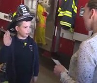 Mass. boy, 8, with cancer becomes firefighter for a day