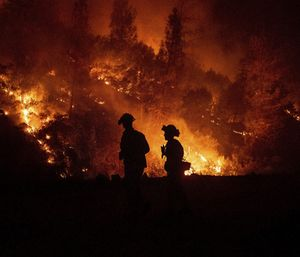 Firefighters monitor a backfire while battling the Ranch Fire, part of the Mendocino Complex Fire. (Photo/AP)