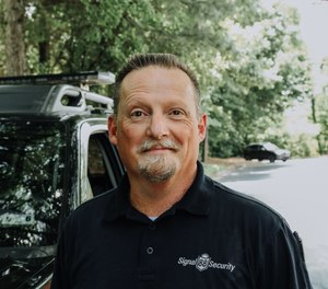 Mark McClure worked in law enforcement for more than 20 years and now operates several Signal 88 Security franchises with his business partners. McClure found the Signal 88 business model appealing because it provides experienced officer-operators with administrative and sales support. (image/Signal 88)